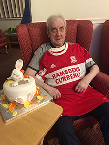 Billy James - dementia sufferer - with his MFC mementoes