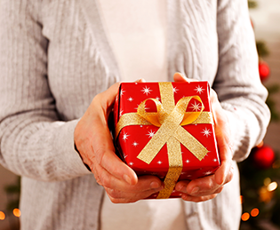 elderly lady with Christmas gift