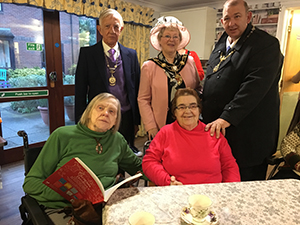 Residents at care home enjoying their Christmas fayre