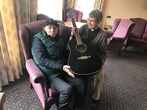Guitarist Keith gets a special gift from pastor