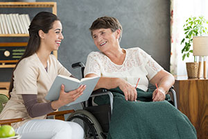 Carer and woman in wheelchair in a care home