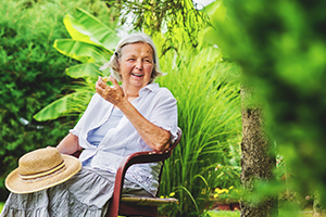Woman Living With Dementia and Gardening