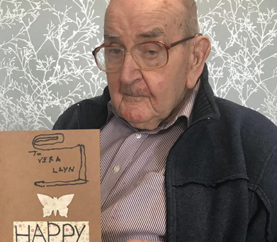 A man from Aaron Court Care Home holding a card he had made