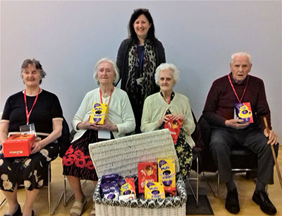 Elderly residents visiting a school to see Egg-cellent Easter display
