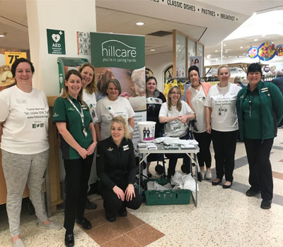 Care home staff packing shopping for children's cancer charity