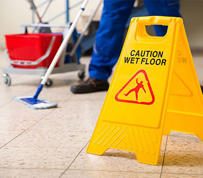 Using wet floor sign while mopping to keep care home insurance valid