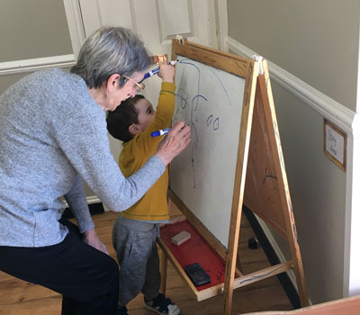 Toddler and elderly resident engaging in activities and joint play