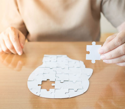 Woman from RCH Care Homes finishing a dementia jigsaw