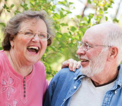 Elderly friends from Orchard Care Homes laughing