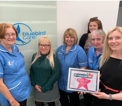 Bluebird Care staff with award