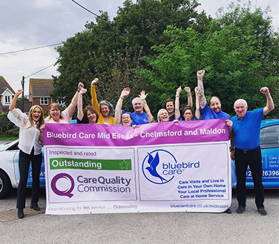 Bluebird Care Mid Essex celebrating their Outstanding review