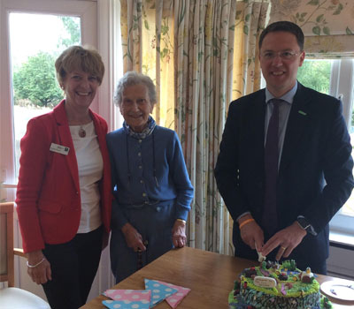 Care home residents and local MP celebrating opening of new eco-garden