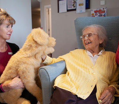 Resident from Great Oaks care home with robotic dog
