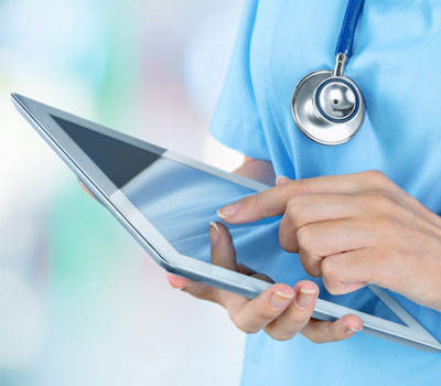 Nurse using care home technology after CQC State of Care report