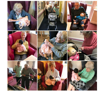 Care home residents participating in Doll Therapy