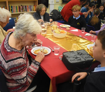 Stevenage nursing home residents at a primary school for lunch