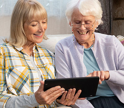 Two people watching a TV advert on a tablet