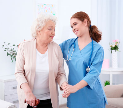 A resident & care home nurse in a bright lighting in a care environment
