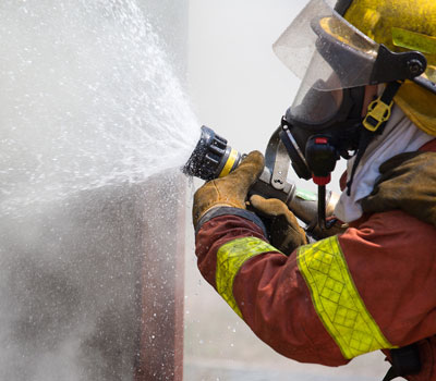 Firefighter tackling medical oxygen fires