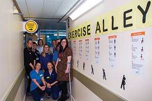 Nurses promoting strength and balance with wall graphics