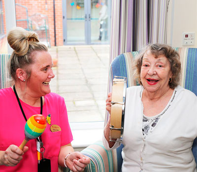 Laughing resident with good mental health in care home