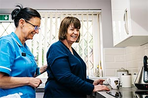 care worker and service user manage staffing levels