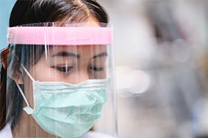 girl wearing PPE for COVID-19 antibody tests