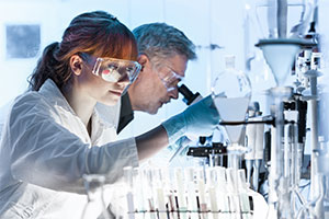Man and woman in lab reducing gender gap