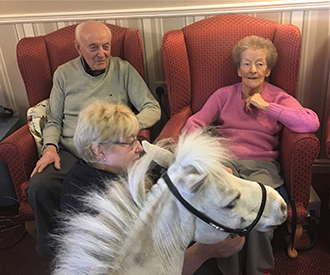 Blondie with 2 care home residents