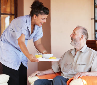 Care home nurse helping old man - Care Sourcer launches free health and wellbeing support