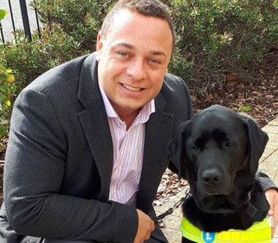 Daniel Williams with his guide dogs who helps him with his sight loss