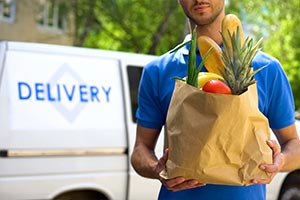 Man delivering groceries to carry on caring