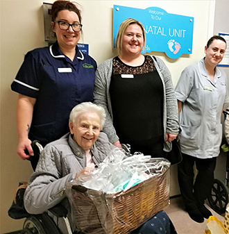 The Beeches Care Home deputy manager Rachel Harris, home manager Jess Brown and carer Amy Trattles with resident Janet Wren when they dropped off donations to the neonatal unit at University Hospital of North Tees on Random Act of Kindness Day.