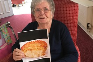 Resident Eileen Connolly taking part in National Pie Day activities at Halton View Care Home.