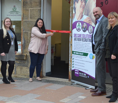 Ribbon cutting at SRS Care Solutions office